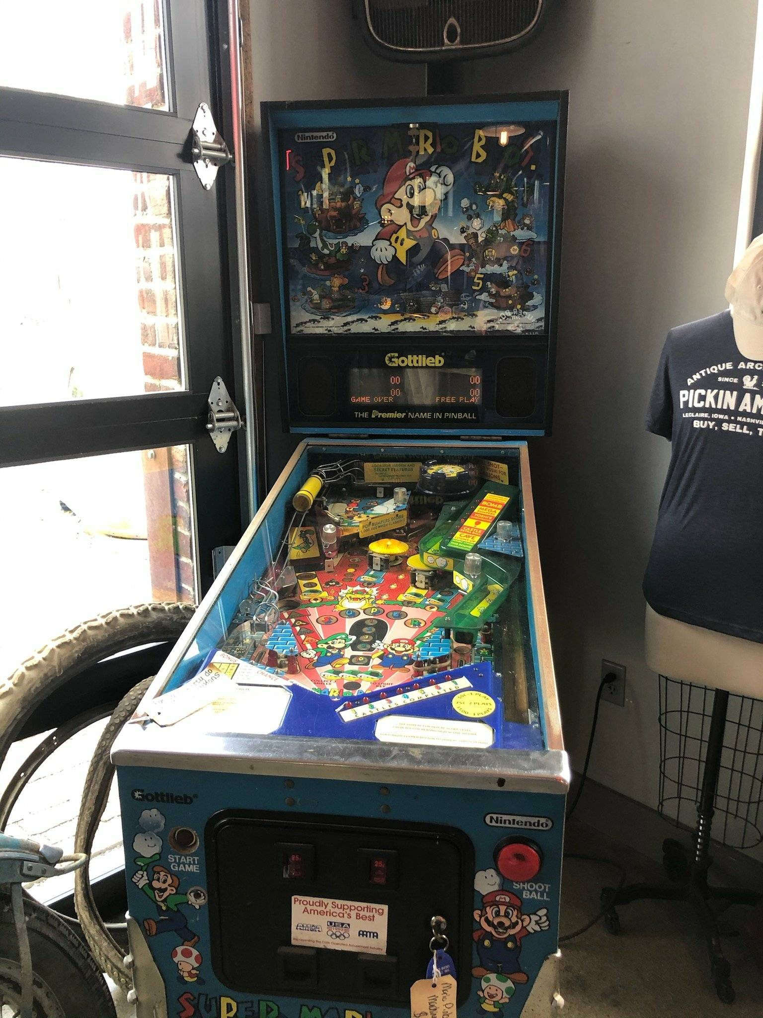 Super Mario Pinball machine with price tag cut off in photo